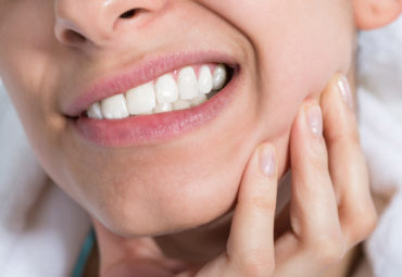 woman with toothache pain in charlotte